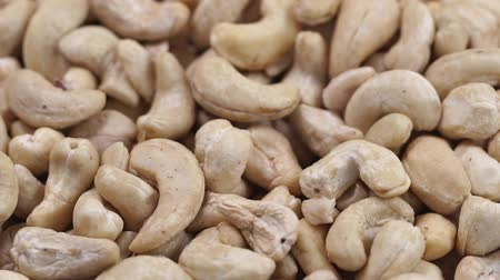 kesudió : Cashew closeup. Rotating nuts background