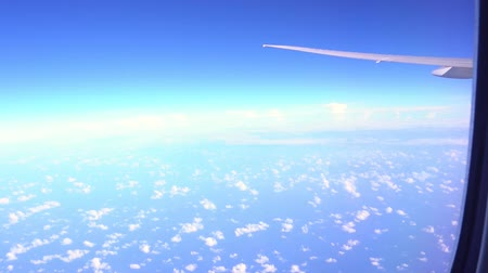 Мальдивы : View from airplane window to the sky and plane wing