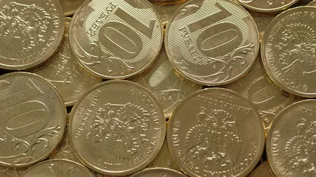 ten : Rubles coins rotating, closeup. Nobody