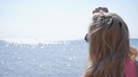 waterline : Blond woman relaxing and looking to the sea