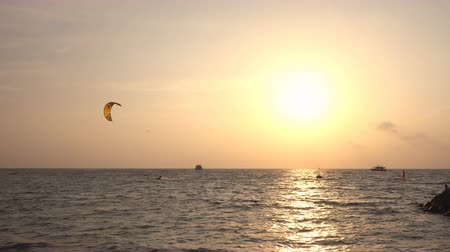 kite boarding : Kite surfer riding with kitesurf on sunset Stock Footage