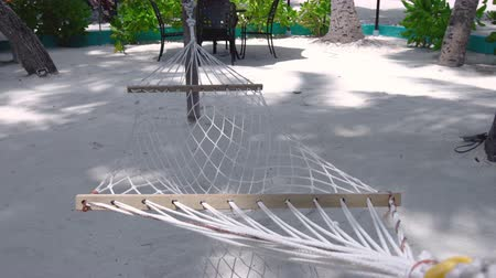 Hammock on sandy beach. Nobody Stock Footage