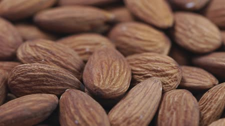 Almond closeup. Rotating nuts background