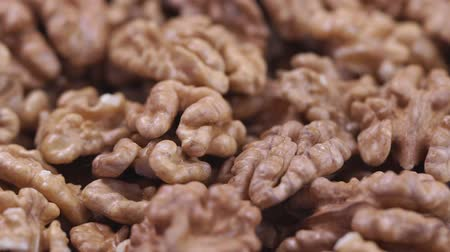 Walnut closeup. Rotating nuts background