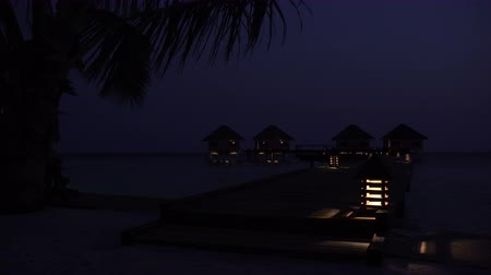 lodge : Luxury water lodges in the dusk. Evening scene with bungalows at the sea