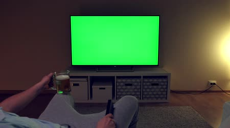 tv channel : Watching tv with green screen at home interior