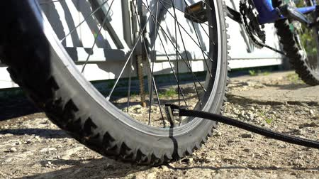 air pump : Pumping up bicycle wheel outdoor Stock Footage