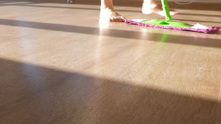 houseclean : Unrecognizable woman wash laminate floor with mop
