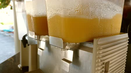 infused water : Dispensers making orange juice at hotel bar Stock Footage