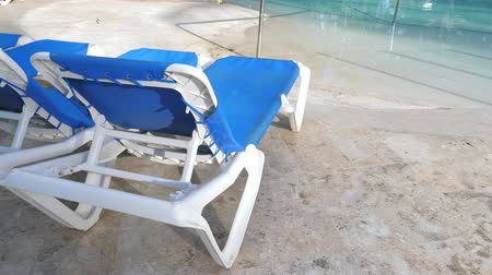 deck chairs : Sun beds at poolside Stock Footage