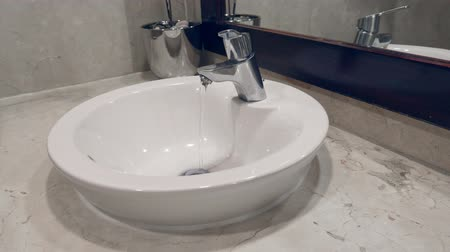 waterdrop : Faucet with running water