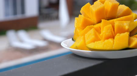 manga : Half cutted cubes slices ripe mango Stock Footage
