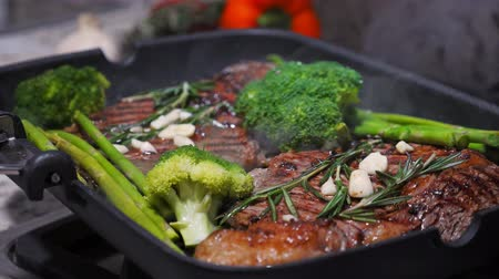 espargos : Cooking beef on grill frying pan on gas oven Stock Footage