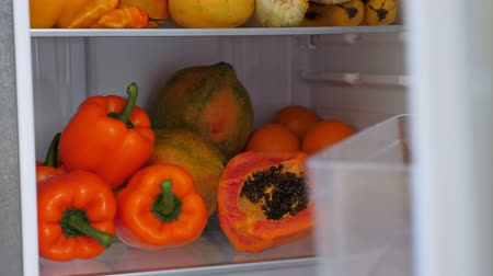 lodówka : Fridge full of fresh colorful orange fruits and vegetables