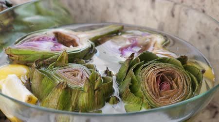 thistle : Artichokes in glass bowl Stock Footage