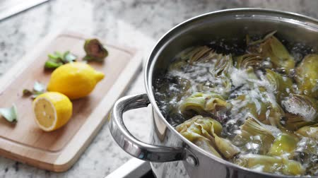 thistle : Boiling and cooking artichokes in saucepan