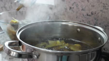 spoons : Boiling and cooking artichokes in saucepan