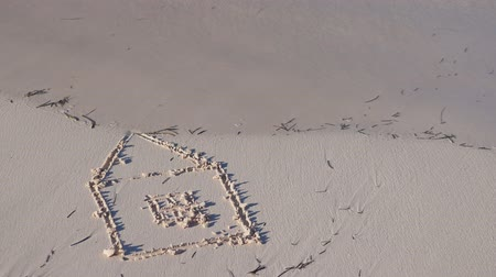 заподлицо : Drawing of house on sand washed away by the ocean wave