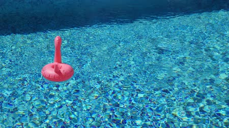 matrace : Inflatable toy of pink flamingo in swimming pool at poolside