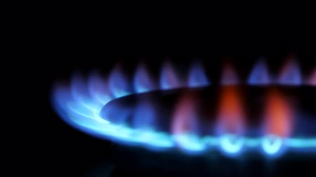 gas burner flame : Kitchen burner flaming in the dark