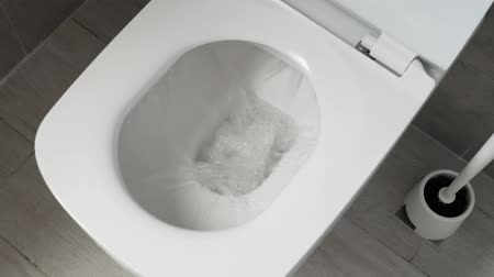 wipe away : White toilet bowl in a bathroom. Flush water away Stock Footage
