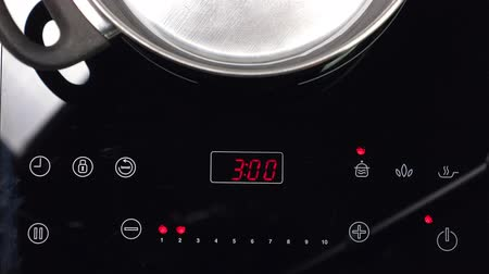 cooktop : Switch on Induction stove and set power of heating
