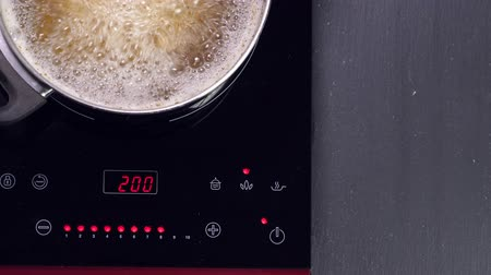 cooktop : Boiling pasta in pan on induction oven Stock Footage
