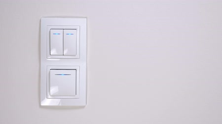 press wall : Three white lighting switch at the apartment