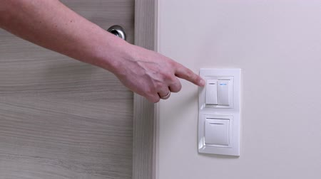 press wall : Door handle and white lighting switches at modern apartment