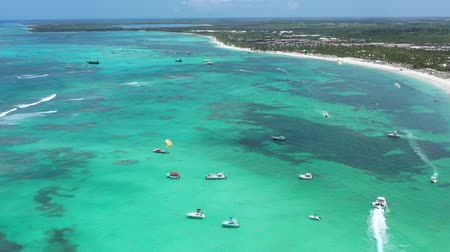 dominican : Aerial view on tropical beach of caribbean sea with speedboats