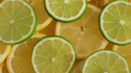 limon : Lemon slices with one cut lime slice closeup, macro food summer background