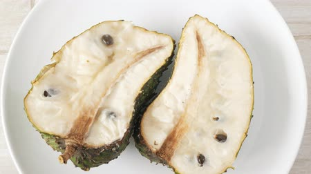 vla : Closeup of green soursop graviola, exotic, tropical fruit Guanabana on plate