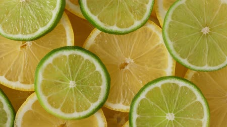 citron : Lemon slices with one cut lime slice closeup, macro food summer background