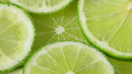 limon : Lime slices closeup, macro food summer background, fruits top view Stock Footage