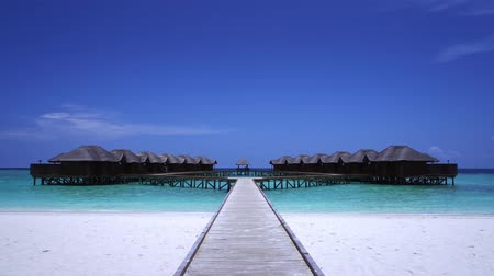 домик : Tropical travel pristine beach with water bungalows
