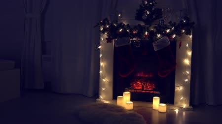 ストッキング : New year and Christmas celebration near fireplace in cozy room 動画素材
