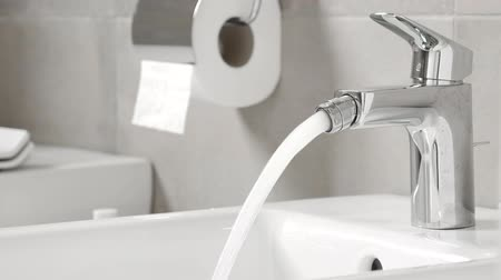 toilet paper : White ceramic bidet at modern restroom interior