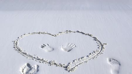 pristine : Handwriting heart drawn on sand at the beach Stock Footage