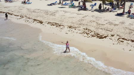 dominicana : Aerial view from drone on caribbean sea beach with woman walking along shore