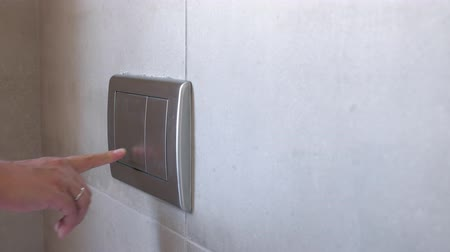 loo : Man push flush button in modern restroom Stock Footage