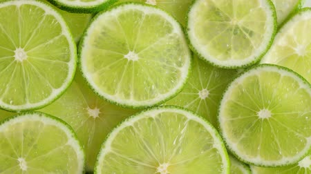 limon : Lime slices closeup, food summer background, top view. Rotate