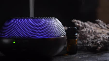 gyógyászati : Diffuser for essential oils diffusing steam on black background