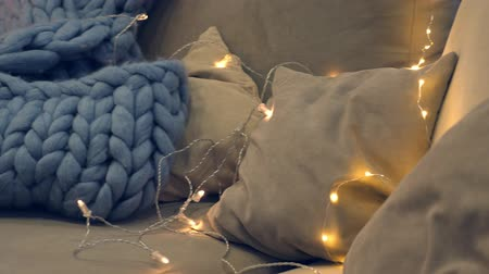 gyapjas : Merino plaid on sofa with pillows near new year tree
