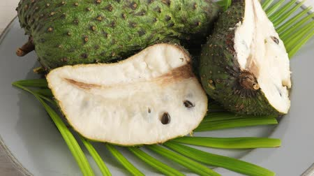 tropical fruit : Closeup of green soursop graviola, exotic, tropical fruit Guanabana on plate