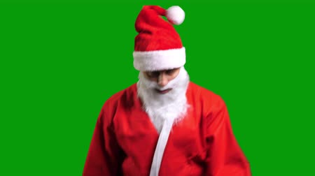 Santa Claus in red suit dancing on green chroma key background