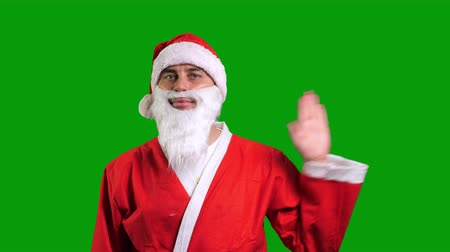Santa Claus in red suit wag hand palm on green chroma key background Stockvideo