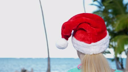 Woman in Santa Claus Hat on beach Stock Footage