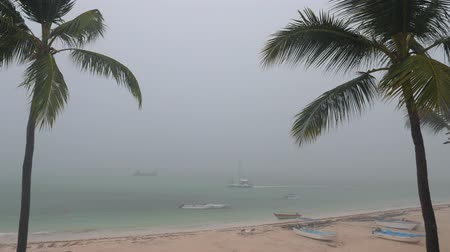View on Storm and rain on tropical beach from balcony