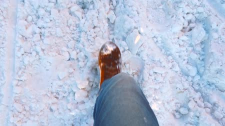 следы : Feet of  man go on snow  winter, Slow motion