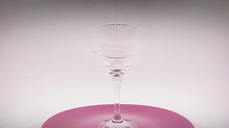fodormenta : Glass of cocktail with  mint on white background on the spinning plate (120 fps)